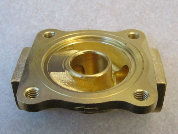 Inside the solenoid valve's brass base.