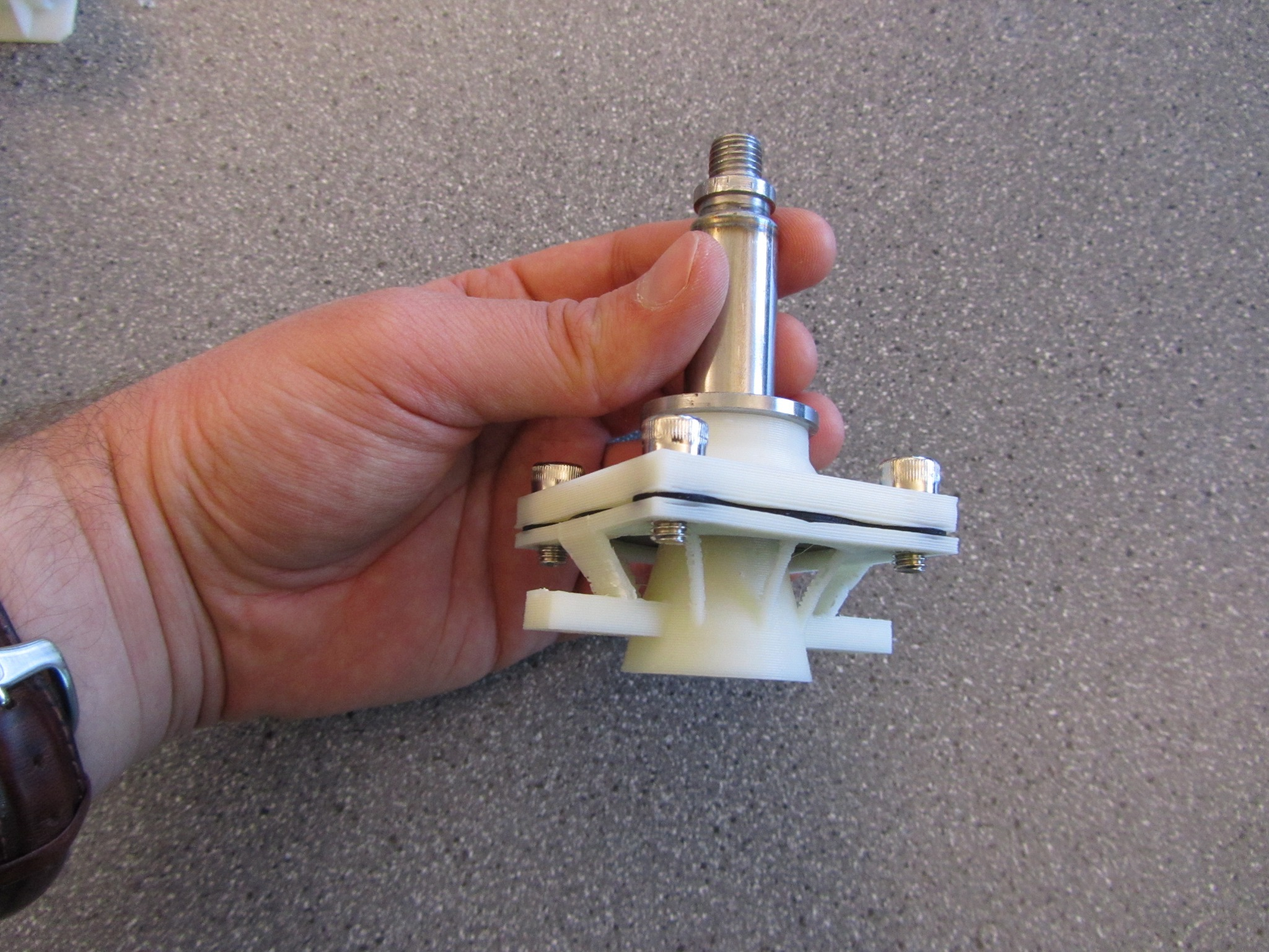 Picture of a remade underwater solenoid valve with 3D-printed structure.